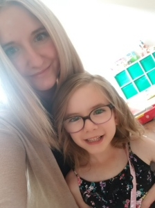 Melissa a 25 year old with long blonde hair and brown eyes with her daughter Hailey a 5 years old with brown hair and brown eyes.