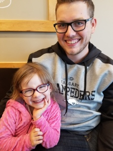 Photo of James and Hailey sitting together smiling taken on the day we got the official adoption letter.